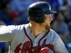 Braves catcher Brian McCann watches his seventh-inning homer during Atlanta's 8-3 win over the Cubs in Chicago. It was McCann's second homer of the evening.