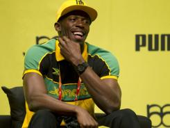 Jamaica's world record holder Usain Bolt reacts as he gives a news conference at a cultural center in Daegu, South Korea on Thursday.