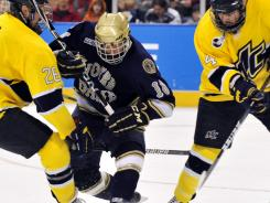 Forward T.J. Tynan and Notre Dame could be caught in the middle of the proposed WCHA-CCHA merger and be without a conference for hockey by 2013-14.