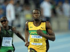 Usain Bolt  wins a 100-meter heat in 10.10 seconds at the IAAF World Championships in  Daegu, South Korea on Saturday.