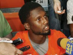 The NCAA is investigating Miami quarterback Jacory Harris' involvement with a convicted Ponzi scheme architect.