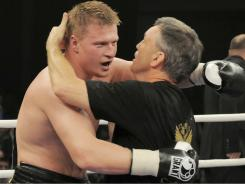 Alexander Povetkin of Russia, left, hugs his coach Teddy Atlas after winning the WBA heavyweight title against Ruslan Chagaev Saturday.