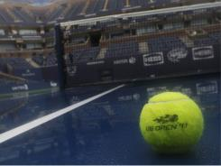 A tennis ball is shown on the wet court of Arthur Ashe Stadium at the Billie Jean King USTA National Tennis Center in Flushing Meadows, N.Y. Hurricane Irene continues to jog up the East Coast and is expected to bring the storm across Long Island, N.Y.
