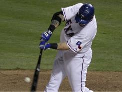 Josh Hamilton broke out of a slump with a homer and three RBI to help the AL West-leading Rangers beat the chasing Angels.