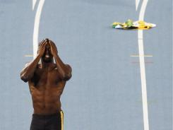 Jamaica's Usain Bolt reacts as he is disqualified for a false start in the men's 100-meter final at the world championships in Daegu, South Korea, on Sunday.