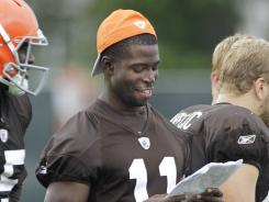 Cleveland Browns wide receiver Mohamed Massaquoi (11) looks over a play sheet with Greg Little at training camp in Berea, Oh.