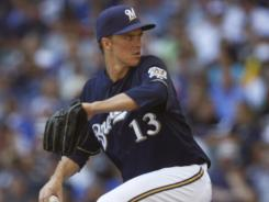 Zack Greinke improved to 10-0 at home this season, and the streaking Brewers won for the 27th time in their last 32 games.
