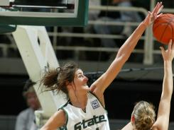 Alyssa DeHaan, very adept at blocking shots for Michigan State's basketball team, now will try to block spikes for the Grand Valley State (Mich.) volleyball team.