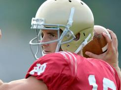 Notre Dame quarterback Dayne Crist, who started the first nine games of 2010 before suffering a ruptured knee patella tendon, won the preseason competition against sophomore Tommy Rees, who started and won the final four games.