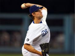 Clayton Kershaw tossed his fifth complete game of the year to give the Dodgers their first winning month of 2011.