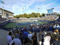 Spectators pack in at the new show court, Court 17, which made its debut Monday.