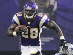 Minnesota Vikings running back Adrian Peterson races away from Dallas Cowboys defensive tackle Jay Ratliff during a preseason game Aug. 27.