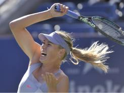 Maria Sharapova fires a forehand in her come-from-behind victory against Heather Watson of Great Britain.