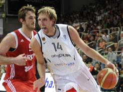 Dirk Nowitzki, right, will pace Germany in EuroBasket 2011 beginning Wednesday in Lithuania.
