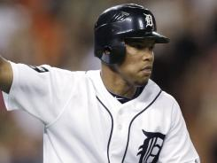 The Tigers' Ramon Santiago celebrates his solo home run against the Royals in the 10th inning on Tuesday,