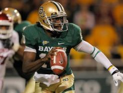 Baylor quarterback Robert Griffin III  surged to the lead in the final voting of this year's Heisman Watch.
