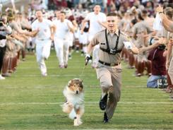Texas A&M mascot Reveille leads the team onto the field before a game in 2010. The Aggies are leaving the Big 12 after this year.
