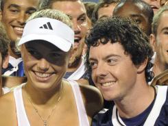 Caroline Wozniack, of Denmark and boyfriend Rory McIlroy.
