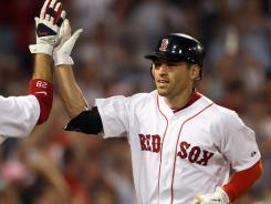 Jacoby Ellsbury crosses home plate after hitting a two-run homer in the sixth inning against the New York Yankees in a 9-5 victory at Fenway Park.
