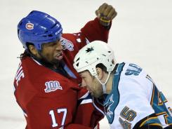 "Georges Laraque, left, says of the enforcer role: ""We don't like to show weakness. That's the way it is. But even tough guys have weakness."""