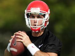 Quarterback Aaron Murray, dropping back to pass during Georgia's practice in Athens on Aug. 4, had a 154.48 passer rating in 2010.