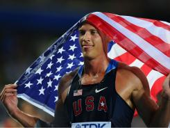 Trey Hardee celebrates with his country's flag after winning the men's decathlon at the IAAF World Championships Sunday in Daegu, South Korea.