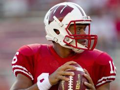 Russell Wilson had an impressive debut for Wisconsin in a 51-17 thrashing of UNLV on Thursday.