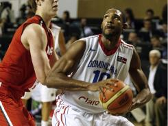 Al Horford, right, led the Dominican Republic with 17 points, but it wasn't enough to overcome Canada.