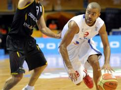 Tony Parker, right, scored 32 points to help France remain unbeaten at the European Championship.