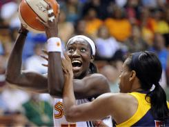 Tina Charles, left, posted the fifth triple-double in WNBA history as the Sun beat the Eastern Conference-leading Fever.