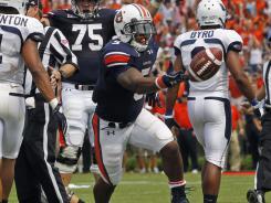Auburn running back Michael Dyer celebrates his game-winning touchdown against Utah State.