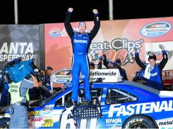 Carl Edwards celebrates winning the Great Clips 300 at Atlanta Motor Speedway after working his way from the back of the pack after a penalty in a pit stop early in the race.