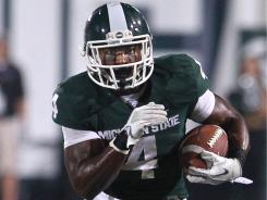 Michigan State running back Edwin Baker breaks free of Youngstown State at Spartan Stadium in East Lansing, Mich.The Spartans won 28-6.
