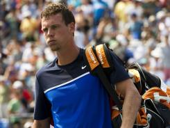 The Czech Republic's Tomas Berdych, the ninth seed, walks off the court after retiring with a shoulder injury Saturday during his third-round match against 20th-seeded Janko Tipsarevic of Serbia.