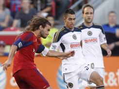 Real Salt Lake's Kyle Beckerman (5) shoots the ball past Justin Mapp (22) of the Philadelphia Union for a goal  during the first half.