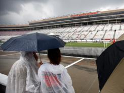 Fans wait Sunday at soggy Atlanta Motor Speedway for a race that never happened.