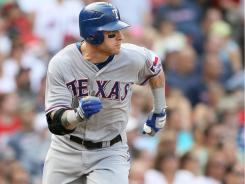 Josh Hamilton had just one hit in the Rangers' 11-4 win over the Red Sox Sunday, but it was a big one: a bases-loaded triple in Texas' seven-run sixth inning.