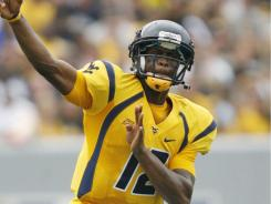 Geno Smith got off to a strong start in West Virginia's season opener. The quarterback was 26-of-35 passes, tossing for 249 yards.