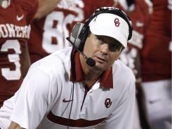 Oklahoma head coach Bob Stoops says college athletics appears headed toward super conferences.