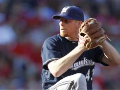 Milwaukee pitcher Randy Wolf tossed eight scoreless innings on Monday to send the Brewers a 4-1 victory over the Cardinals.