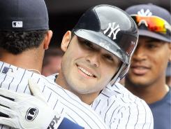 Jesus Montero celebrates his first Major League home run in the fifth inning of the Yankees' 11-0 win over the Orioles on Monday.