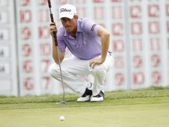 Webb Simpson lines up a putt on the 18th green during the final round of Deutsche Bank Championship.