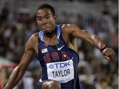 American Christian Taylor competes in the men's triple jump final at the World Championships in Daegu, South Korea, on Sunday. Taylor won gold in his first trips to worlds.