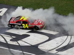 Jeff Gordon celebrates after his win Tuesday in Atlanta, the 85th Sprint Cup victory of his career.