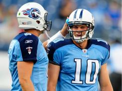 """Mentoring:  Veteran quarterback Matt Hasslbeck, left, is being watched closely by backup Jack Locker, the Titans' first-round draft pick. """"The Titans love Jake,"""" Hasselbeck said. """"But they are going to go at his pace."""""""