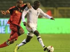 American Jozy Altidore (right) is challenged by Belgium's Vincent Kompany during a friendly in Brussels on Tuesday.