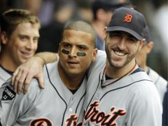 Starter Justin Verlander, right, hugs Victor Martinez in the dugout after Martinez's grand slam in the seventh inning of Wednesday's game.  Martinez's home run gave the Tigers the lead and it led to Verlander notching his 22nd win.