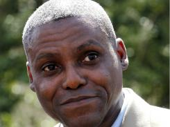 In this April 11, 2011 file photograph, Olympic gold medalist Carl Lewis announces in Mount Holly, N.J., his candidacy for the New Jersey state senate seat to represent his hometown of Willlingboro.