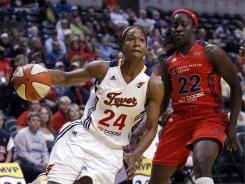 Forward Tamika Catchings, left, gets past Mystics guard Matee Ajavon as she drives the baseline during the Fever's 87-69 win in Indianapolis.