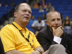 Shock majority owners Bill Cameron, left, and David Box watch from the sidelines during a July game in Tulsa.